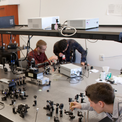 Students working with equipment in a laboratory