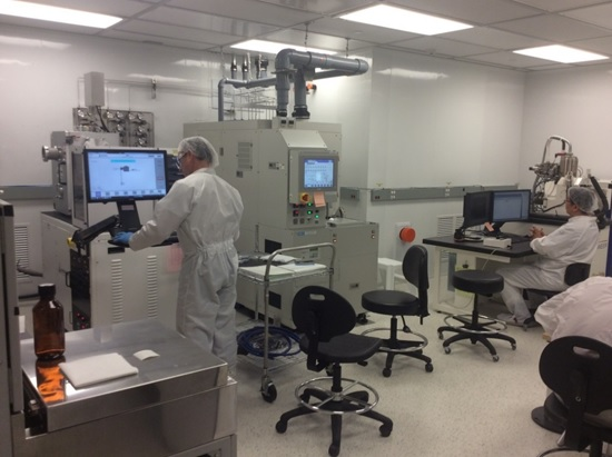 Researchers working amongst equipment in one of the White Clean Room facilities at the CRPuO