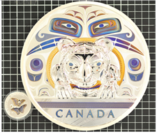 Small silver coin with the image of two butterflies on the surface next to the left of a larger silver coin with colourful images of eyes, a tiger and other shapes on the surface. Both overlaid on a black and white grid.