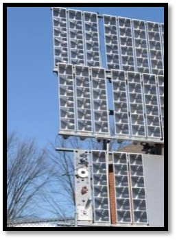 Image of 3 large solar panels outside