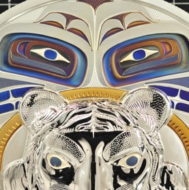 Image of a metallic coloured tiger head with 2 colourful eyes looking on in the background
