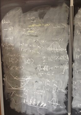 Image of a chalk board with scientific writing on it