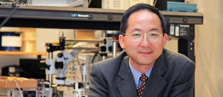 Headshot of Dr. Jianping Yao in his lab