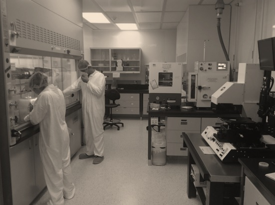 Researchers working amongst equipment in the Yellow Clean Room facilities at the CRPuO